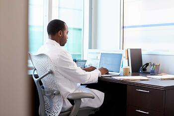 Doctor-looking-at-computer-screen