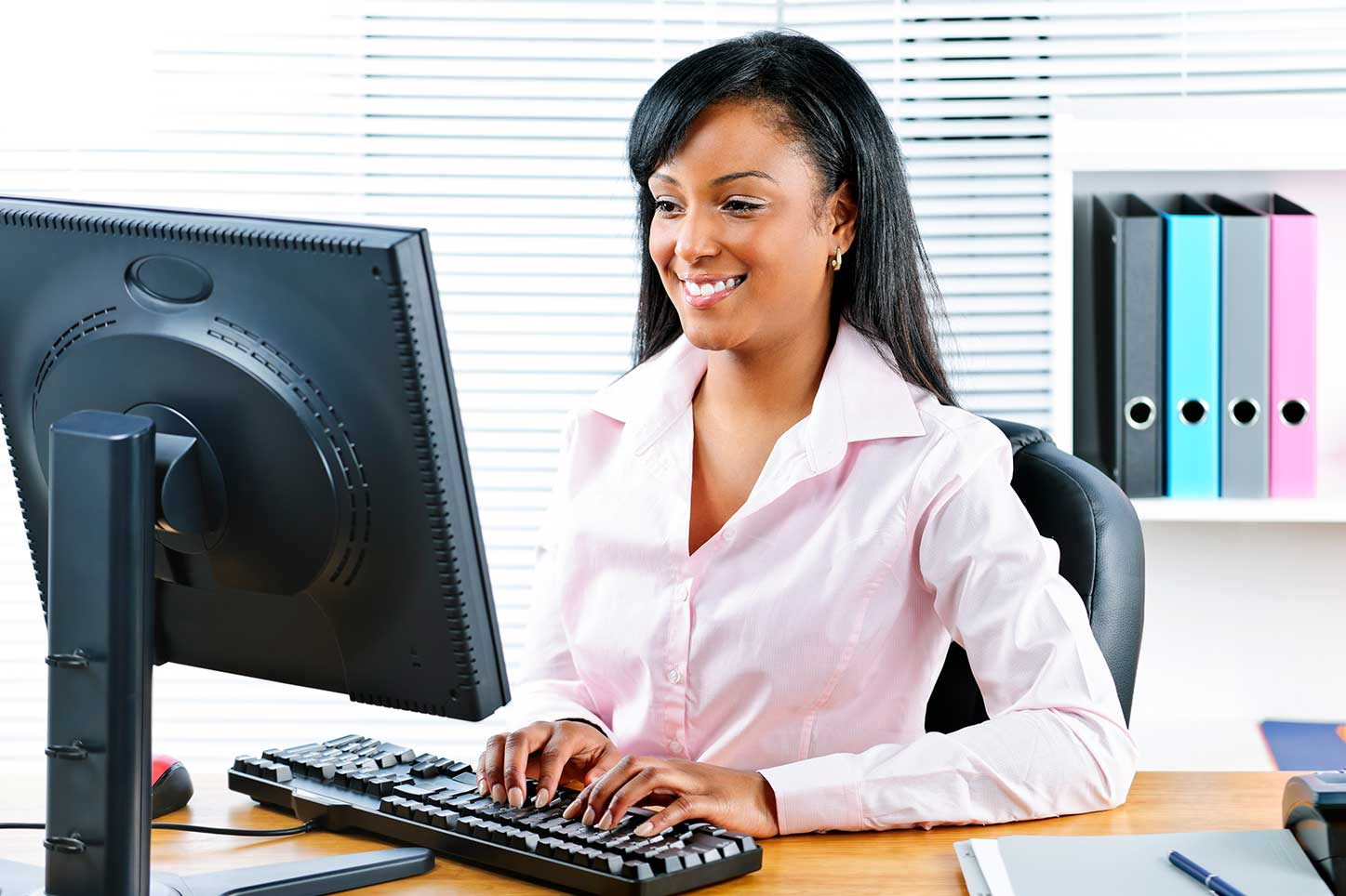 Payor Enrollment-woman-typing