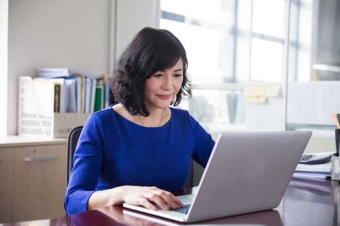 Staff Member Looking at Files on Computer.jpg