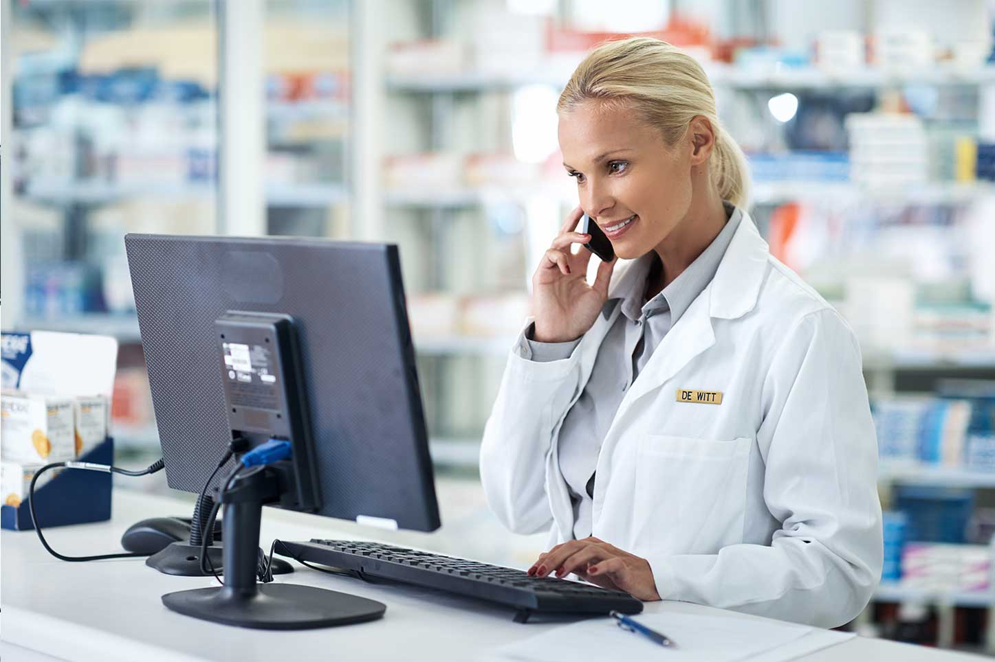 pharmacist-looking-up-information