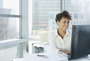 Woman working at desk in offic-1