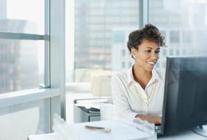 Woman working at desk in offic