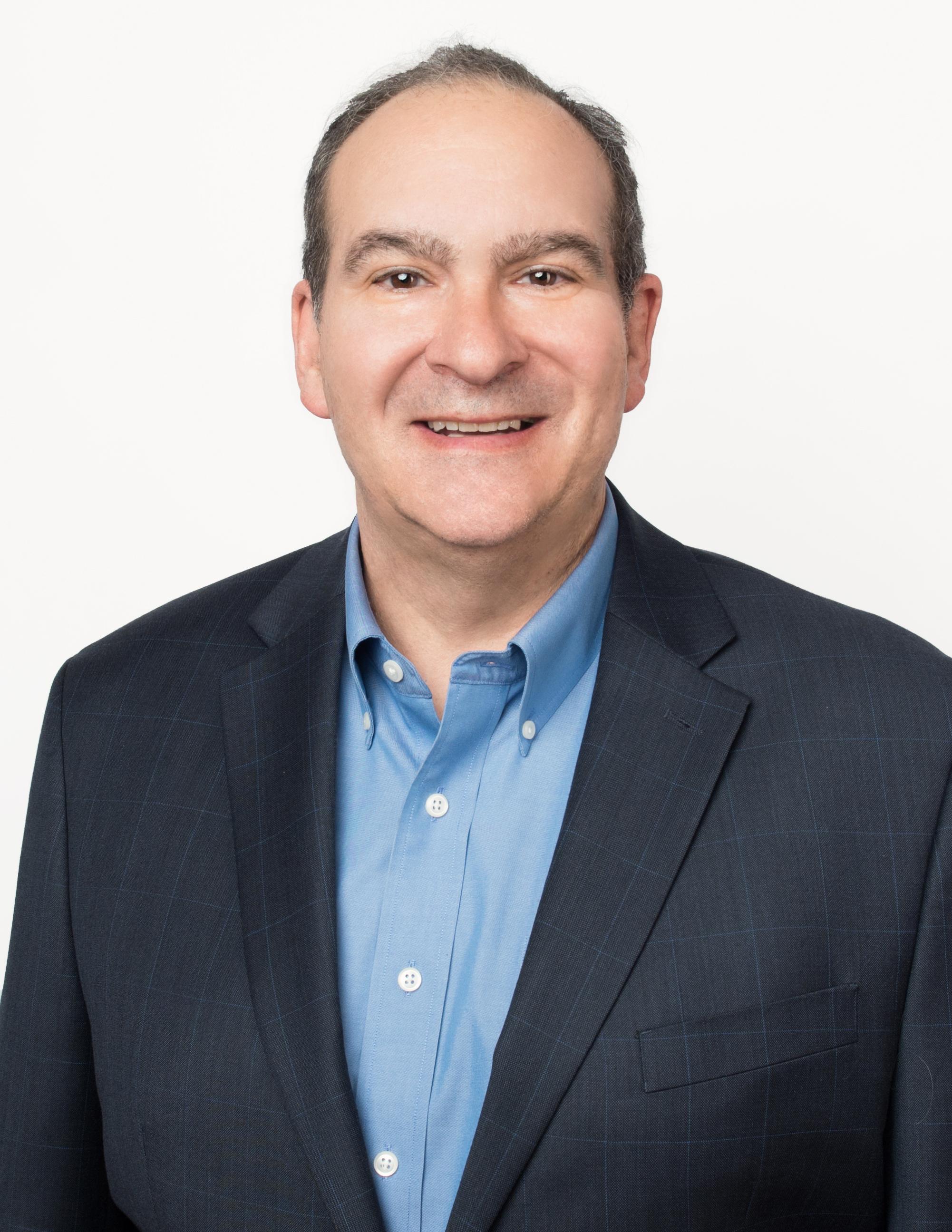Headshot photo of Keith Belton